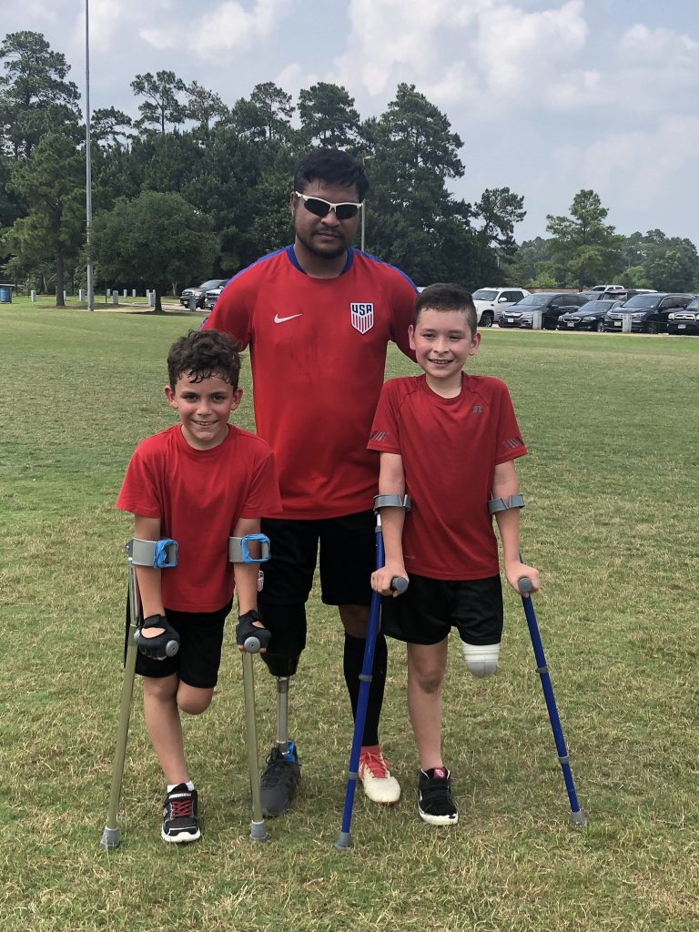 Robert Ferguson with Kids in his Amputee Soccer Program